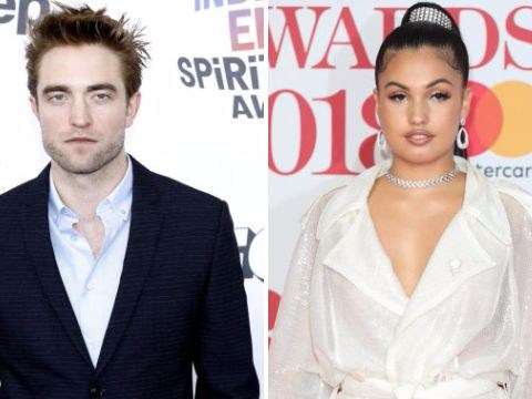 Robert Pattinson is 'sticking like glue' to singer Mabel after the pair 'hit it off at LFW'