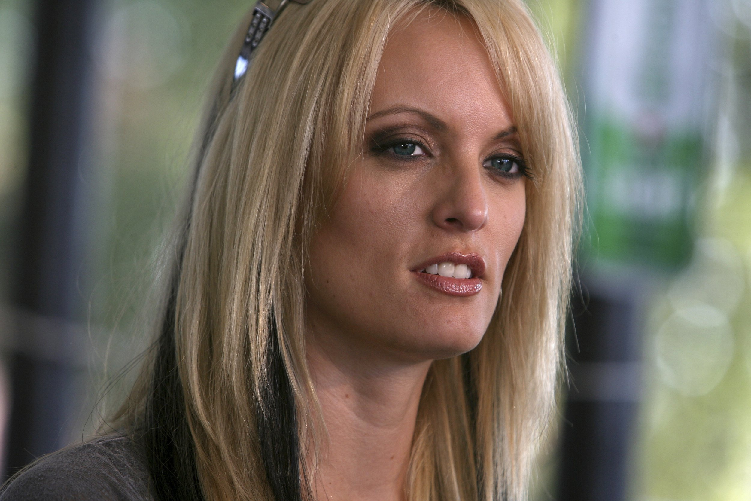 This photo taken July 3, 209, shows Adult-movie star Stormy Danielsat Rooster's Country Bar in Delhi, La., for the last leg of her statewide listening tour. A tabloid magazine held back from publishing Daniels' 2011 account of an alleged affair with Donald Trump after the future president's personal lawyer threatened to sue, four former employees of the tabloid's publisher told The Associated Press. (Arely D. Castillo/The News-Star via AP)