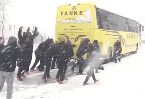 Philadelphia women's basketball team push bus out of the snow