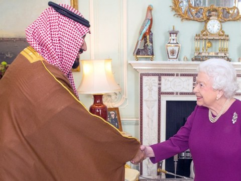 Queen and Saudi Arabia's Prince Salman shake hands amid protests over his visit