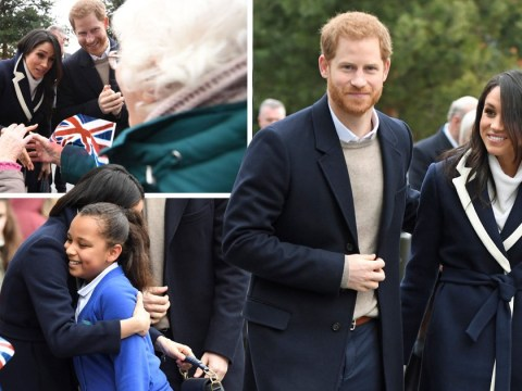 Prince Harry and Meghan Markle hug young fans as they arrive in Birmingham for International Women's Day engagement