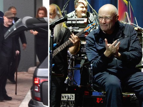 Phil Collins performs from chair after leaving hotel with a walking stick following dramatic fall