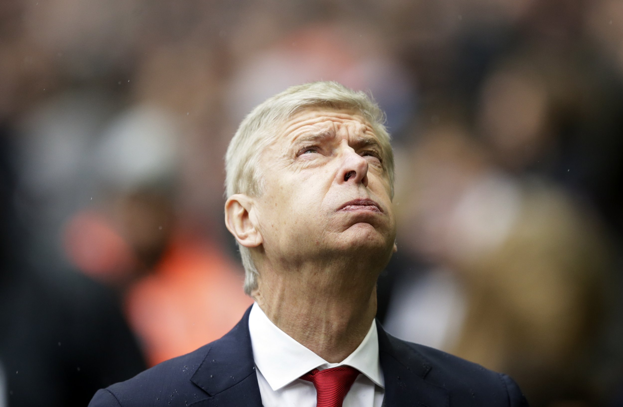 FILE - In this Saturday, Feb. 10, 2018 file photo, Arsenal's manager Arsene Wenger looks on before their English Premier League soccer match against Tottenham Hotspur at Wembley Stadium, London. Irked that his future is again under scrutiny, Arsenal manager Arsene Wenger reminded his critics he ???turned the whole world down??? to stay at the club and refused to comment on an end-of-season review regarding his position. (AP Photo/Tim Ireland, file)