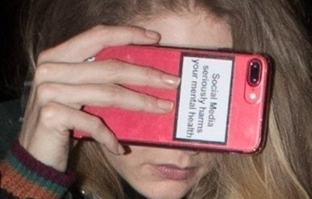 BGUK_1157635 - ** RIGHTS: ONLY UNITED KINGDOM ** Paris, FRANCE - Gigi Hadid covers her face with a cell phone cover that says ???Social Media Seriously Harms Your Mental Health??? while out and about during Paris Fashion Week in Paris, France. Pictured: Gigi Hadid BACKGRID UK 28 FEBRUARY 2018 BYLINE MUST READ: BEST IMAGE / BACKGRID UK: +44 208 344 2007 / uksales@backgrid.com USA: +1 310 798 9111 / usasales@backgrid.com *UK Clients - Pictures Containing Children Please Pixelate Face Prior To Publication*