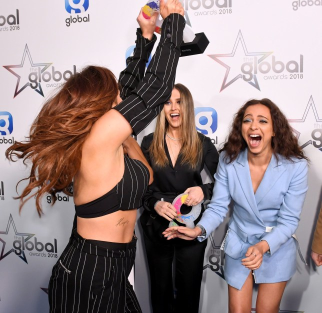Mandatory Credit: Photo by James Gourley/REX/Shutterstock (9446051cg) Little Mix - Jesy Nelson, Jade Thirlwall, Perrie Edwards and Leigh-Anne Pinnock - Best Song 'Power', Best Group and Best British Artist or Group The Global Awards, Press Room, Eventim Apollo, London, UK - 01 Mar 2018