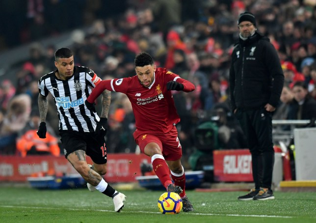 "Newcastle United's Robert Kenedy (left) and Liverpool's Alex Oxlade-Chamberlain battle for the ball during the Premier League match at Anfield, Liverpool. PRESS ASSOCIATION Photo. Picture date: Saturday March 3, 2018. See PA story SOCCER Liverpool. Photo credit should read: Anthony Devlin/PA Wire. RESTRICTIONS: EDITORIAL USE ONLY No use with unauthorised audio, video, data, fixture lists, club/league logos or ""live"" services. Online in-match use limited to 75 images, no video emulation. No use in betting, games or single club/league/player publications"