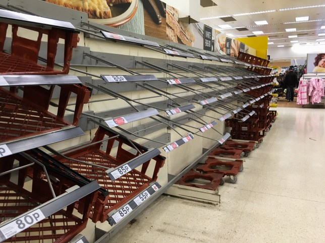 The bread aisle. There are many empty shelves inside the Tesco Supermarket in Plymouth, Devon. This is blamed on the recent bad weather. 04/03/2018
