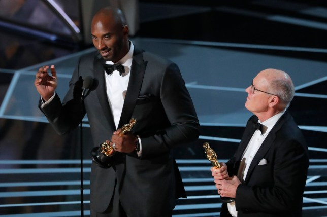 "90th Academy Awards - Oscars Show - Hollywood, California, U.S., 04/03/2018 - Kobe Bryant and Glen Keane (R) accept the Oscar for Best Animated Short Film for ""Dear Basketball."" REUTERS/Lucas Jackson"