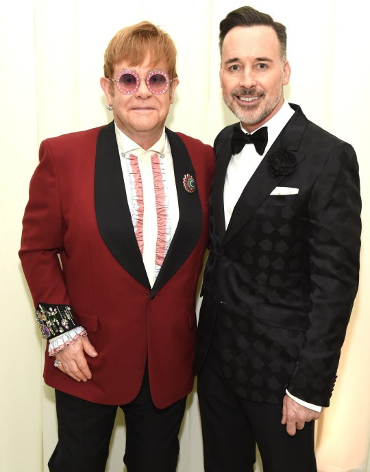 WEST HOLLYWOOD, CA - MARCH 04: Sir Elton John (L) and David Furnish attend the 26th annual Elton John AIDS Foundation Academy Awards Viewing Party sponsored by Bulgari, celebrating EJAF and the 90th Academy Awards at The City of West Hollywood Park on March 4, 2018 in West Hollywood, California. (Photo by Michael Kovac/Getty Images for EJAF)