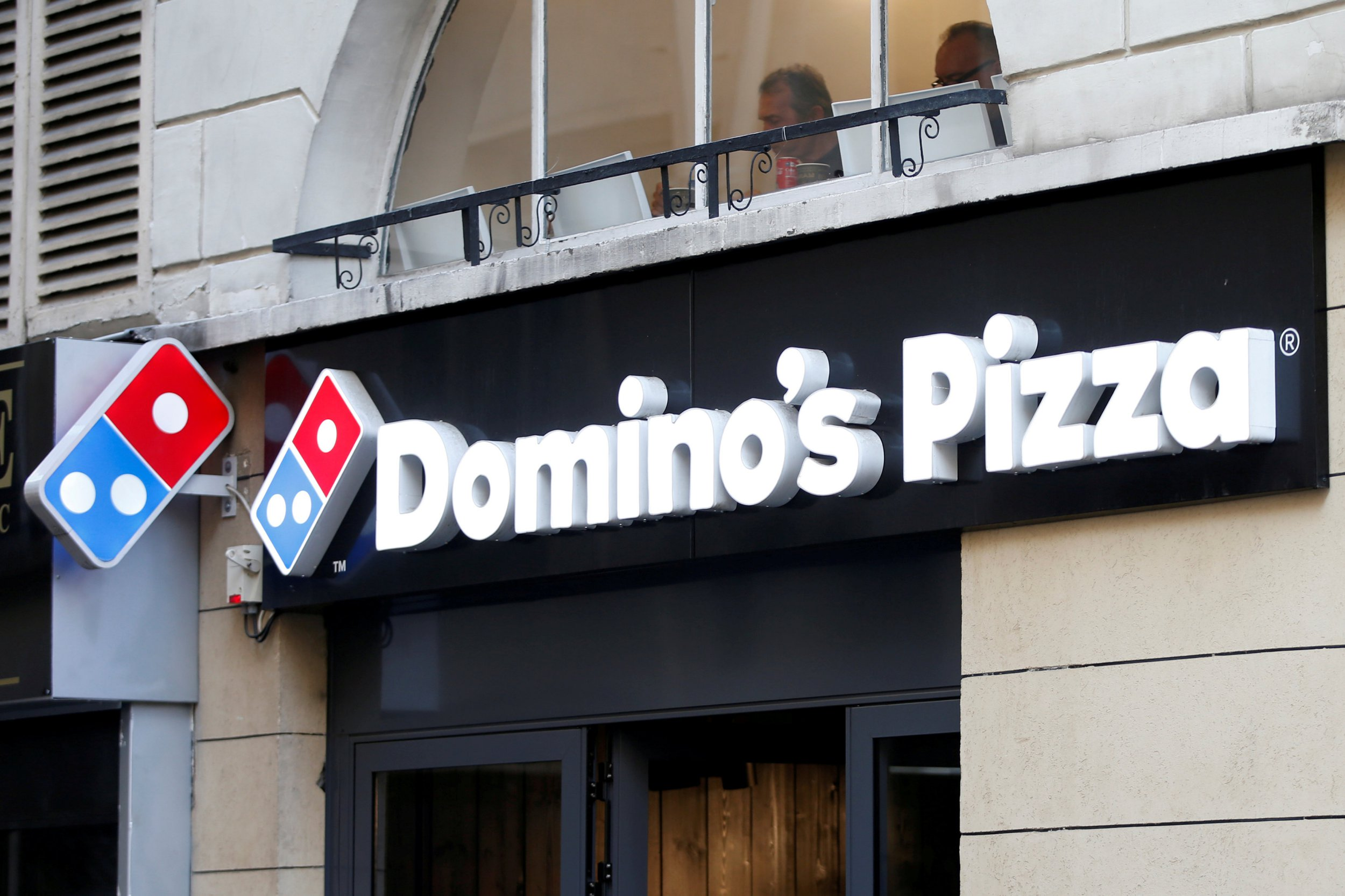 FILE PHOTO: The sign of a Domino's Pizza restaurant is seen in Paris, France, October 27, 2016. REUTERS/Charles Platiau/File Photo GLOBAL BUSINESS WEEK AHEAD SEARCH GLOBAL BUSINESS FOR ALL IMAGES?