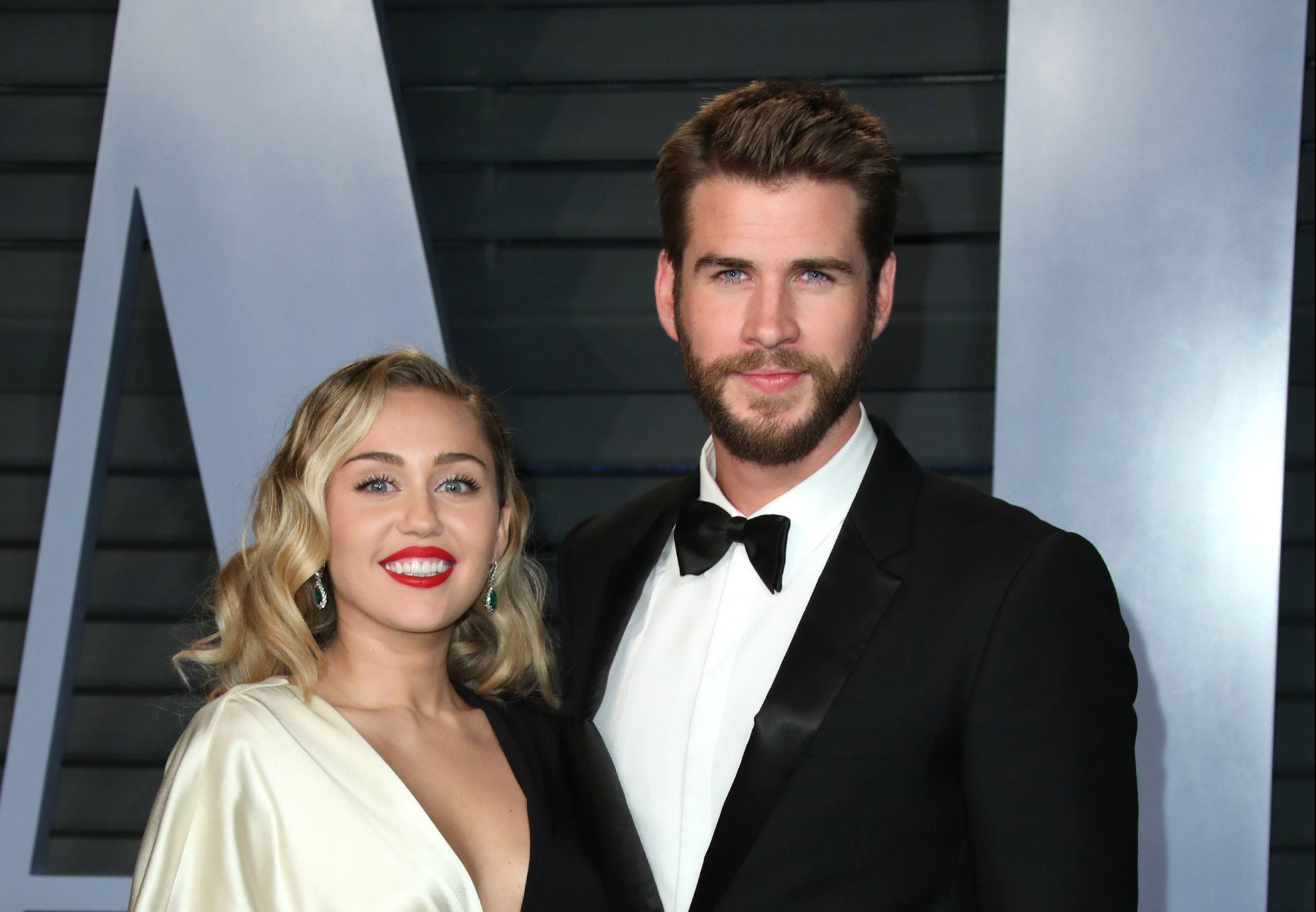 Miley Cyrus and Liam Hemsworth attending the Vanity Fair Oscar Party held in Beverly Hills, Los Angeles, USA