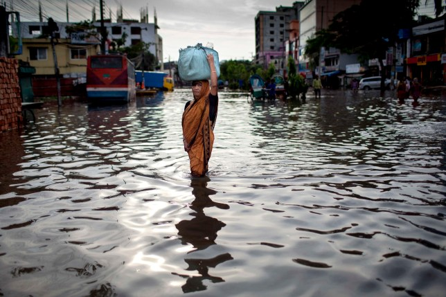 AGRABAD, DHAKA, CHITTAGONG, BANGLADESH - 2017/07/26: An old woman in a flooded area of Chittagong. Chittagong city is facing unprecedented flooding this year due to rising sea level, the release of water from the Kaptai Lake, and the suspension of the Karnaphuli River dredging. The World Bank (WB) has approved additional $47.50 million to help improve water, sanitation, and drainage infrastructure in Chittagong, with the aim of helping about 650,000 inhabitants of the country's prime port city gain access to safe and reliable water. (Photo by K M Asad/LightRocket via Getty Images)