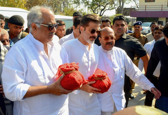 Indian Bollywood actor Boney Kapoor (L), Anil Kapoor (C) and politican Amar Singh (centre R) perform rituals in memory of the legendary late Bollywood actress Sridevi Kapoor in Haridwar on March 8, 2018. The family and friends of Bollywood legend Sridevi Kapoor are paying tribute to the actress following her shock death in February from accidental drowning in a Dubai hotel bathtub at age 54. / AFP PHOTO / --/AFP/Getty Images