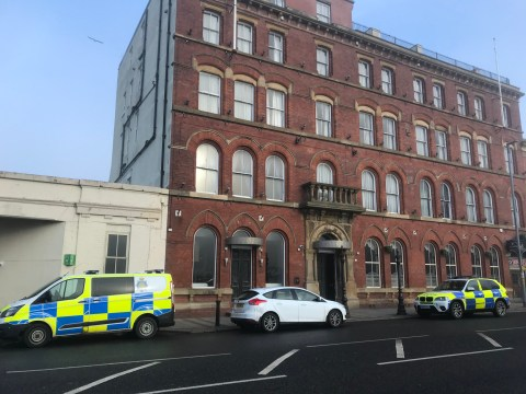 Armed police storm hotel room and 'rescue woman being held hostage'