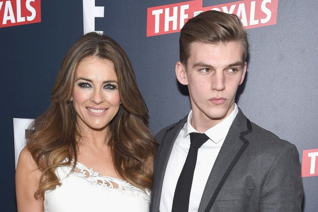 "NEW YORK, NY - MARCH 09: Actress Elizabeth Hurley and nephew, model Miles Hurley attend ""The Royals"" New York Series Premiere at The Standard Highline on March 9, 2015 in New York City. (Photo by Gary Gershoff/WireImage)"