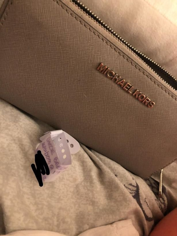 A new mum was ?shocked? after a kind-hearted homeless man went to great lengths to return a designer purse she?d lost on a night out. Jess Beech, 21, was enjoying her first night out since giving birth to daughter Darcie earlier this year, but misplaced her purse in Liverpool city centre. Caption: The purse, containing her daughter Darcie's hospital name tag, lost by Jess Beech in Liverpool city centre, which was later returned after being handed in by a homeless man