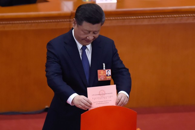 Chinese President Xi Jinping votes during the third plenary session of the first session of the 13th National People's Congress (NPC) at the Great Hall of the People in Beijing on March 11, 2018. China's rubber-stamp parliament is set on March 11, to hand President Xi Jinping free rein to rule the rising Asian superpower indefinitely, with potential abstentions offering the only suspense in the historic vote. / AFP PHOTO / WANG ZHAOWANG ZHAO/AFP/Getty Images
