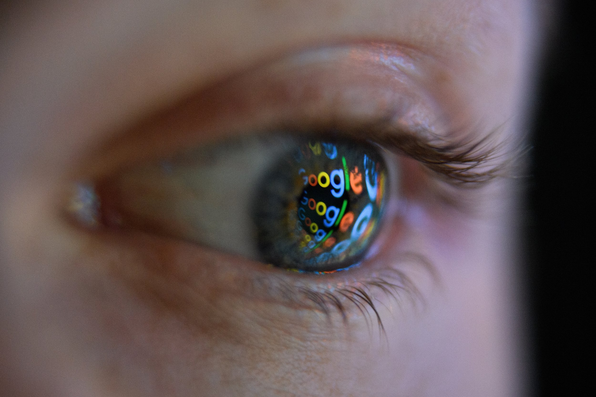 LONDON, ENGLAND - AUGUST 09: In this photo illustration, an image of the Google logo is reflected on the eye of a young man on August 09, 2017 in London, England. Founded in 1995 by Sergey Brin and Larry Page, Google now makes hundreds of products used by billions of people across the globe, from YouTube and Android to Smartbox and Google Search. (Photo by Leon Neal/Getty Images)