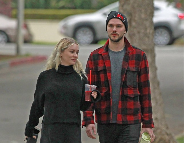 100320, EXCLUSIVE: Nicholas Hoult and model Bryana Holly are still going strong admid rumors his ex Jennifer Lawrence wants to win him back, as the couple are seen out getting a juice in Los Angeles. Nicholas and Bryana appeared happy as they left a grocery store holding their juices. The usually slender model was looking rounder in the belly area, prompting possible baby rumors. Los Angeles, California- Thursday March 8, 2018. Photograph: ?? FlightPhotoAgency. FlightPhotoAgency - Sales 305.798.1514 sales@flightphotoagency.comALL FEES TO BE AGREED BEFORE USAGE