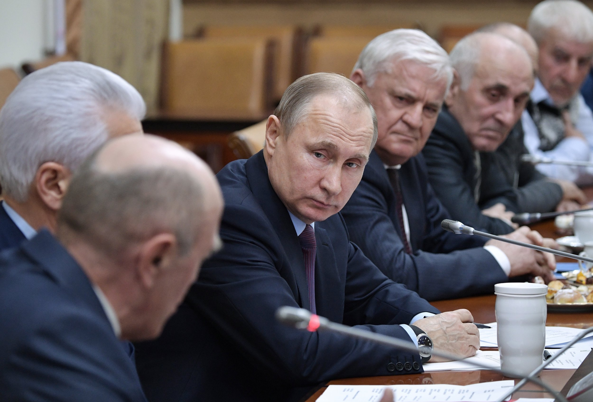 Russian President Vladimir Putin listens during a meeting with officials in Makhachkala, the capital of Dagestan, Russia, Tuesday, March 13, 2018. (Alexei Nikolsky, Sputnik, Kremlin Pool Photo via AP)
