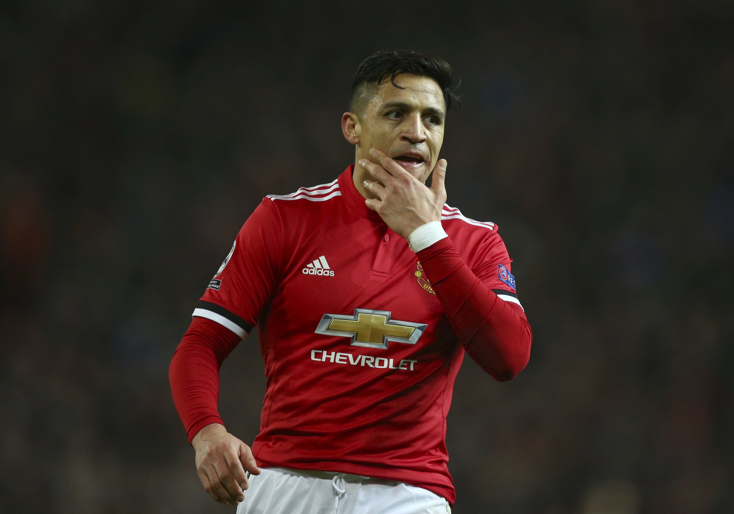 Manchester United's Alexis Sanchez reacts after watching his team miss a chance to score during the Champions League round of 16 second leg soccer match between Manchester United and Sevilla, at Old Trafford in Manchester, England, Tuesday, March 13, 2018. (AP Photo/Dave Thompson)