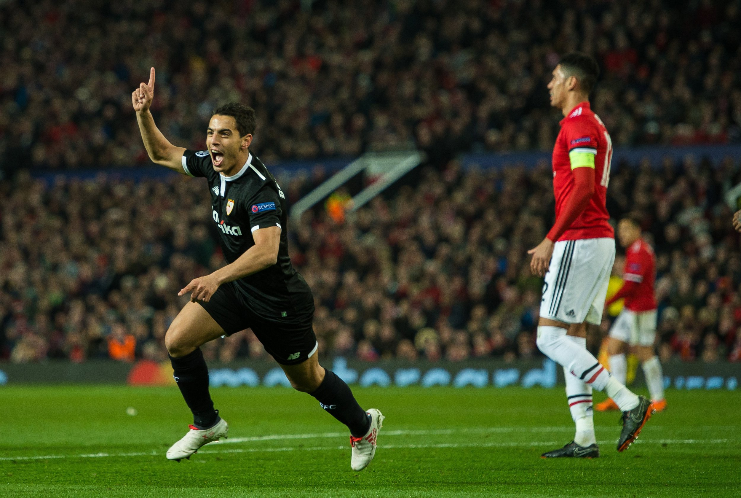 epa06601655 Wissam Ben Yedder (L) of Sevilla celebrates scoring the 2-0 lead during the UEFA Champions League Round of 16 second leg soccer match between Manchester United and Sevilla FC held at Old Trafford, Manchester, Britain, 13 March 2018. EPA/PETER POWELL