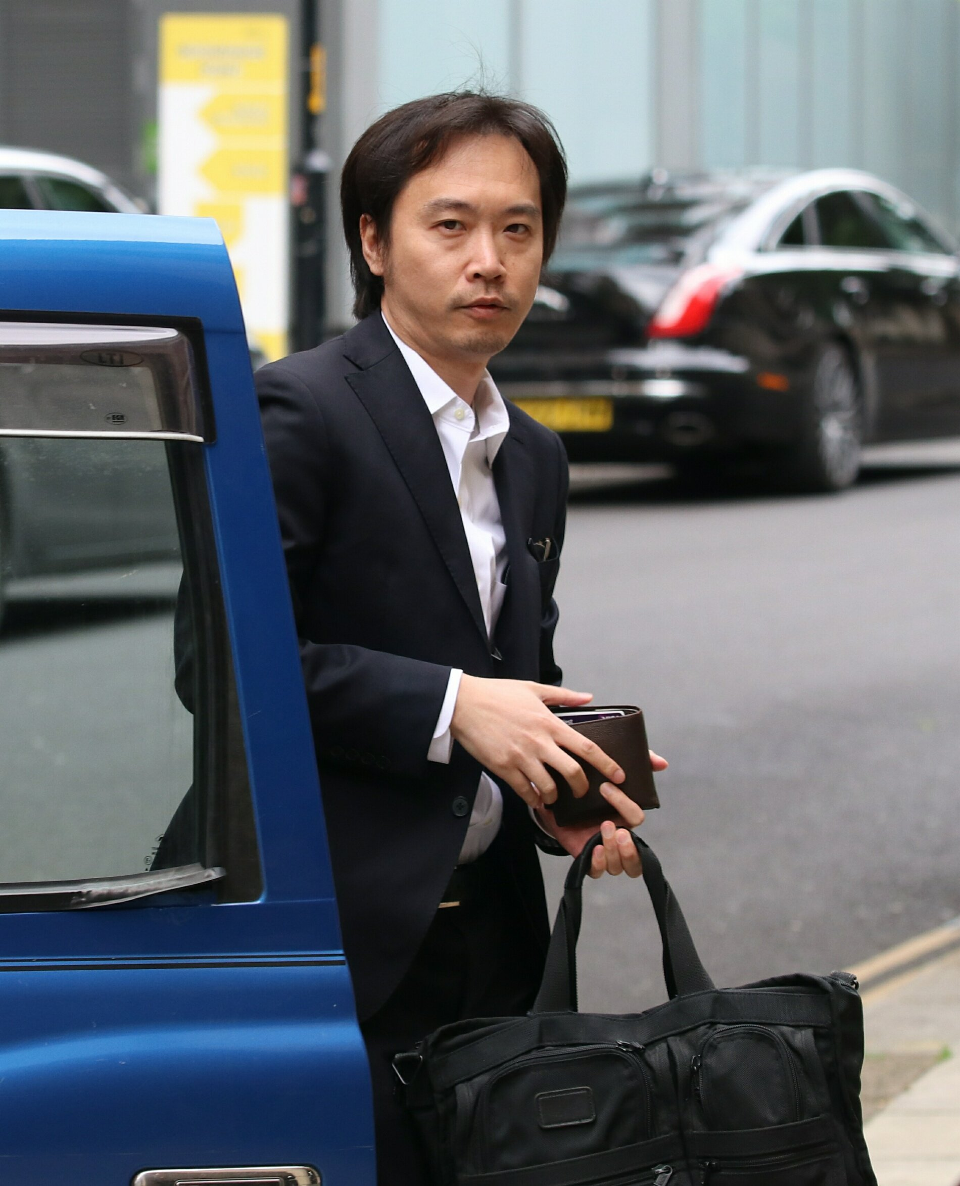 Pic shows Takehiko Ogihara arriving at court. FILE PICTURE Blackfriars Crown Court trial of Nomura Bank Vice President Takehiko Ogihara, for rape and sexual assault. The trial is starting today. 14.3.18 SEE STORY CENTRAL NEWS