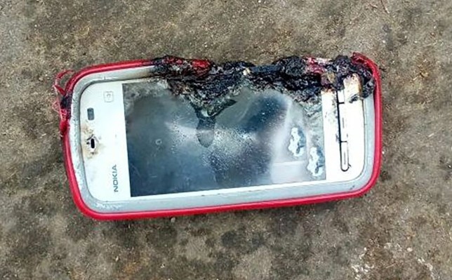 "Pic shows: Nokia 3110 model. An 18-year-old girl is said to have been killed by her Nokia phone when it exploded as she chatted on it. Victim Uma Oram is reported to have been talking on the Nokia smartphone with it plugged in to charge at home in the village of Kheriakani in the eastern Indian state of Odisha. Local media quoted her brother as saying that she had wanted to talk to an unnamed family member just after lunch but found that the phone had run out of charge. She reportedly plugged it in and was talking to the relative when the phone suddenly exploded. She reportedly received injuries to her hand, chest and leg and was knocked unconscious. Still unconscious, she was taken to hospital. Her brother Durga Prasad Oram explained: ""As the battery of the mobile phone was draining out, she plugged it for charging while talking over it simultaneously. ""The cell phone... was put on charging when she started talking to a relative. Its battery exploded suddenly. Before we could know what exactly happened, Uma fell unconscious. She was declared dead at the hospital."" He told local media that the phone was a Nokia 3110 but some media sources said it was a Nokia 5233 smartphone. Pictures of the incident show a damaged phone that looks like the 5233, released in 2010 and Nokia???s cheapest touchscreen smartphone at the time. The 3110 was a pre-smartphone model quite unlike the one seen in pictures taken after the incident. Police have reportedly visited the scene to gather statements. Uma???s body has reportedly been sent for post-mortem. There was no comment reported from Nokia."
