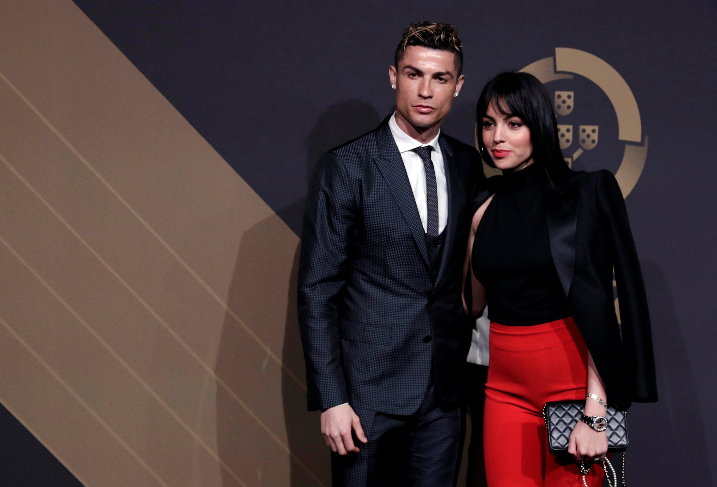 Portuguese soccer player Cristiano Ronaldo and his girlfriend Georgina Rodriguez arrive at the Quina Awards ceremony in Lisbon, Portugal, March 19, 2018. REUTERS/Rafael Marchante