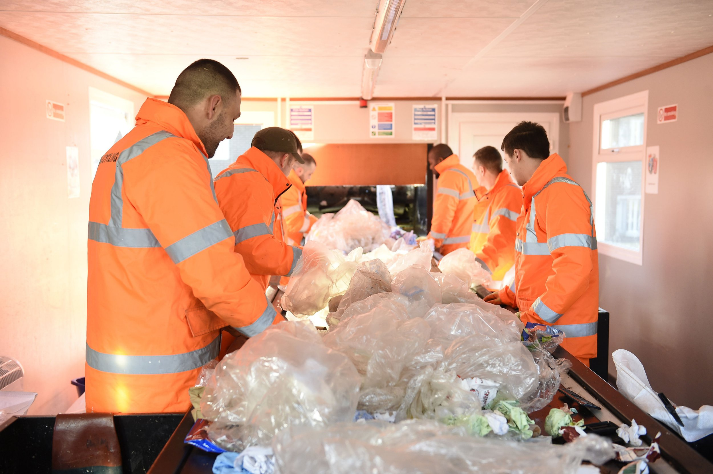 MANDATORY CREDIT: Michael Cooper Undated Michael Cooper handout photo of prisoners taking part in a new recycling project at Maghaberry Prison which is set to halve its waste costs in coming years. PRESS ASSOCIATION Photo. Issue date: Tuesday March 20, 2018. About 30 prisoners sort plastic, tin cans, cardboard, newspaper, broken pallets and waste electric equipment, and the amount going to landfill has been slashed. See PA story ULSTER Recycling. Photo credit should read: Michael Cooper/PA Wire NOTE TO EDITORS: This handout photo may only be used in for editorial reporting purposes for the contemporaneous illustration of events, things or the people in the image or facts mentioned in the caption. Reuse of the picture may require further permission from the copyright holder.