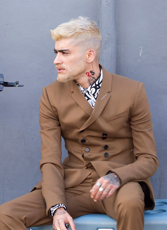 ?250 per pic print / ?250 set online EXC Zayn Malik shows off his latest tattoos and new blonde hair and beard during a video shoot in Miami, Florida.