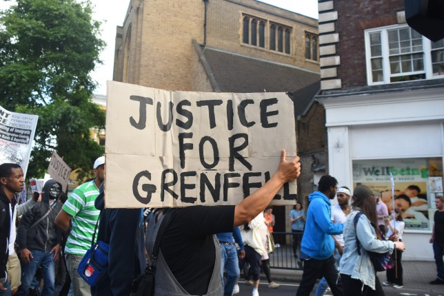 A protest takes place at Kensington and Chelsea Town Hall, following the fire of the Grenfell Tower block, London on June 16, 2017. Protesters gathered outside Kensington and Chelsea Town Hall, to demand justice for those affected by the fire that gutted Grenfell Tower. Emergency workers continued searching for bodies, warning they may never be able to identify some of the victims. (Photo by Alberto Pezzali/NurPhoto) *** Please Use Credit from Credit Field ***