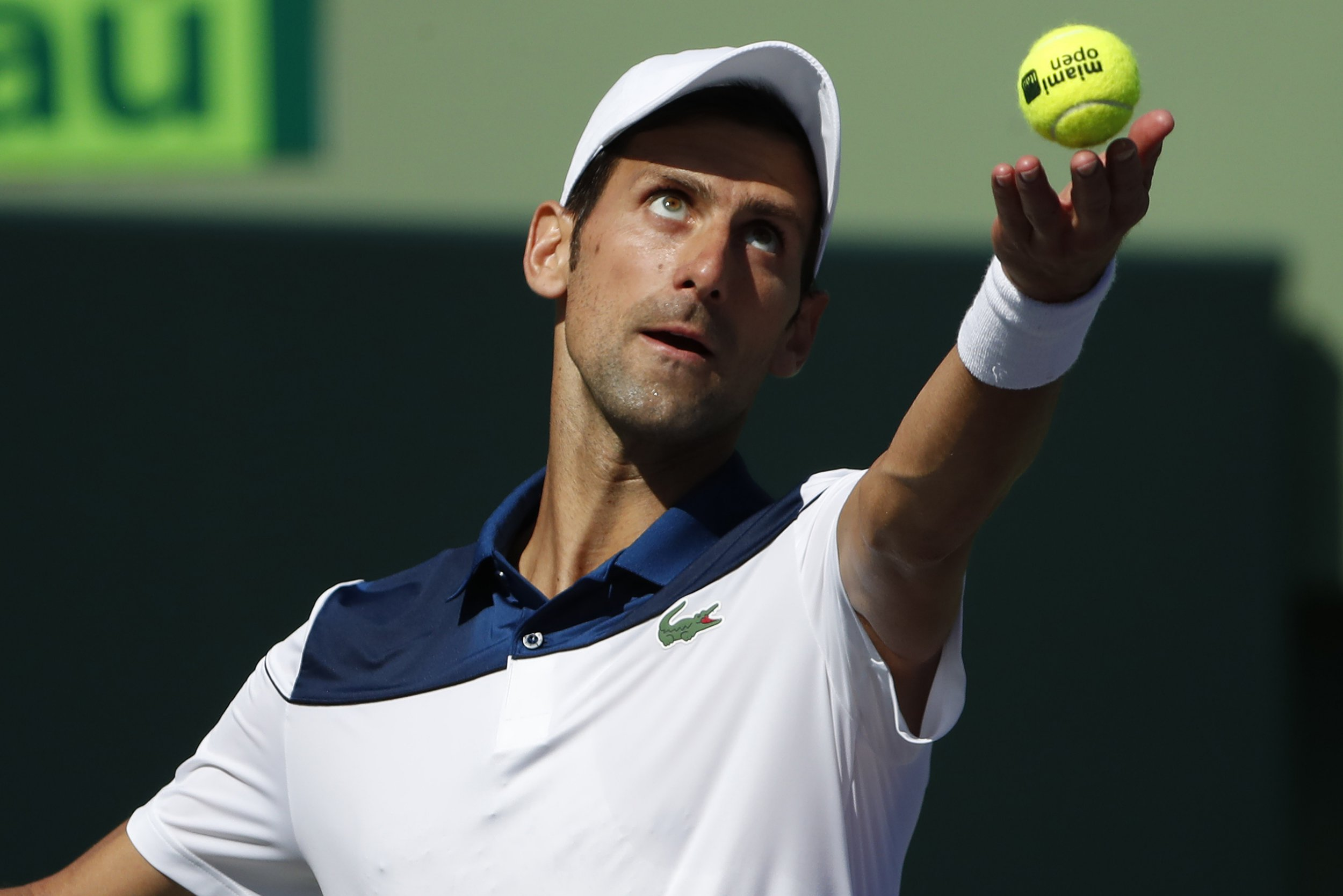 Mar 23, 2018; Key Biscayne, FL, USA; Novak Djokovic of Serbia serves against Benoit Paire of France (not pictured) on day four of the Miami Open at Tennis Center at Crandon Park. Paire won 6-3, 6-4. Mandatory Credit: Geoff Burke-USA TODAY Sports
