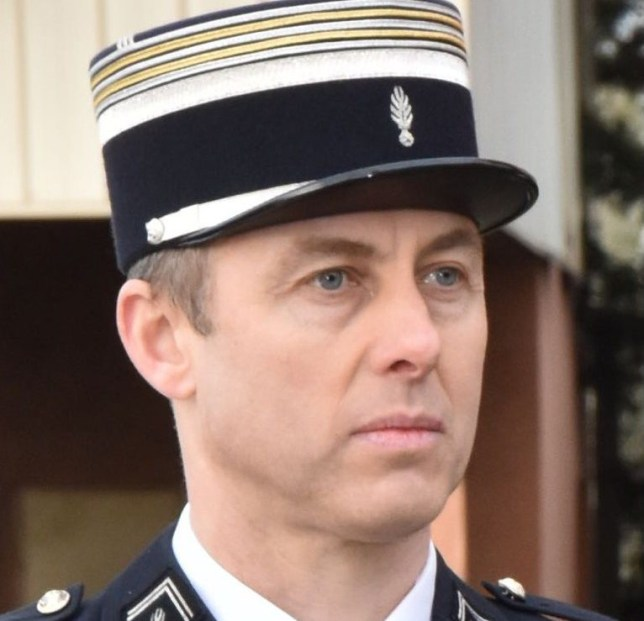 """This handout picture taken in Carcassone military headquarters in 2018 and released by the Gendarmerie Nationale on March 24, 2018 shows French Lieutenant Colonel Arnaud Beltrame who was killed after swapping himself for a hostage in a rampage and siege in the town of Trebes, southwestern France on March 23. Beltrame, 45, was among a group of officers who rushed to the scene in Trebes, near Carcassone, on March 23 after a gunman who claimed allegiance to the Islamic State group, stormed a supermarket and fired at shoppers. Beltrame offered to take the place of a woman the gunman had taken hostage and was shot. He died on March 24 of his wounds, becoming the gunman's fourth victim. / AFP PHOTO / GENDARMERIE NATIONALE / HO / RESTRICTED TO EDITORIAL USE - MANDATORY CREDIT """"AFP PHOTO / GENDARMERIE NATIONALE"""" - NO MARKETING NO ADVERTISING CAMPAIGNS - DISTRIBUTED AS A SERVICE TO CLIENTS HO/AFP/Getty Images"""