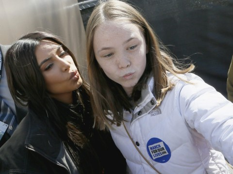 Kim Kardashian poses for selfies with fans at March For Our Lives event with Kanye West and daughter North