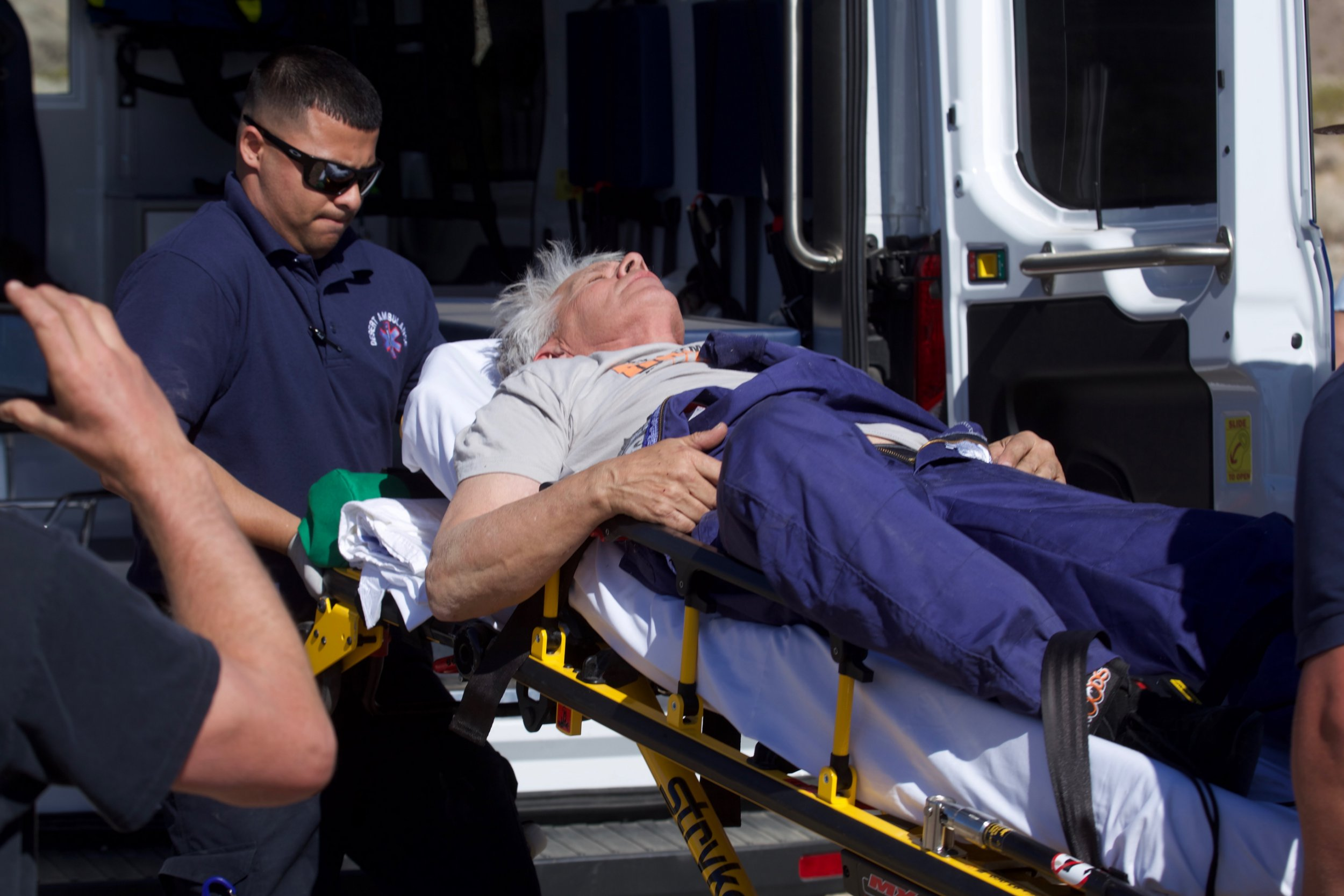 """""""Mad"""" Mike Hughes is carried on a stretcher after his home-made rocket launched and returned to the ground near Amboy, Calif., on Saturday, March 24, 2018. The self-taught rocket scientist who believes the Earth is flat propelled himself about 1,875 feet into the air before a hard-landing in the Mojave Desert that left him injured. (Matt Hartman via AP)"""