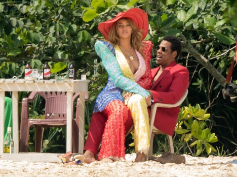 Beyonce is so extra she went to the beach in a full two piece suit