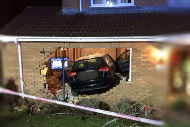 **Mandatory byline** WMAS HART/Caters News - (Pictured: An Audi A4 driver who fled the scene launched their car through the front living room window of this property on Battenhall Rise in Worcester on Friday evening injuring one resident who required hospital treatment.) - A mum and daughter had a lucky escape after a car crashed into their front room whilst they enjoyed a glass of wine in front of the TV. Mel Beattie and her daughter, Tash, were left with serious injuries after the black Audi A4 ploughed into the family home in Worcester, at around 10.30pm on Friday night. Father Robert Beattie, 61, escaped without injury but wife, Mel, 53, suffered seven broken ribs and a punctured lung and their 15- year-old daughter, Tash, suffered two broken ribs and a fractured ankle. SEE CATERS COPY