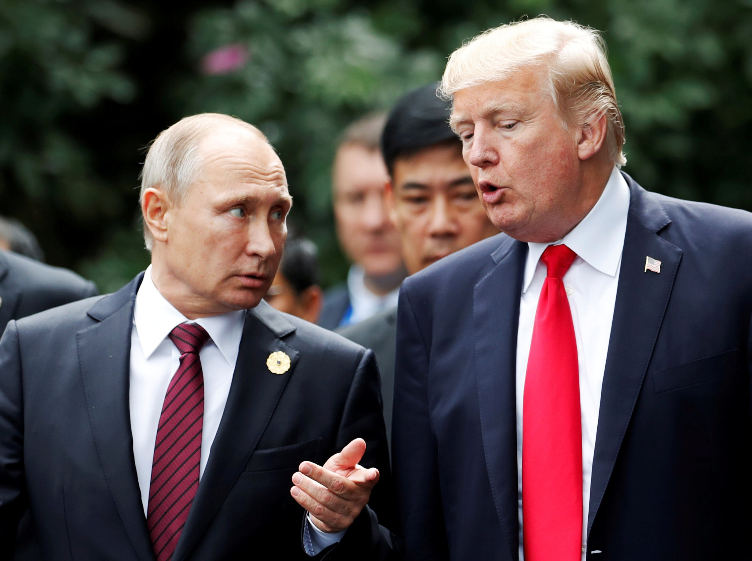 U.S. President Donald Trump and Russia's President Vladimir Putin talk during the family photo session at the APEC Summit in Danang, Vietnam November 11, 2017. REUTERS/Jorge Silva TPX IMAGES OF THE DAY - RC1E7D8D2110