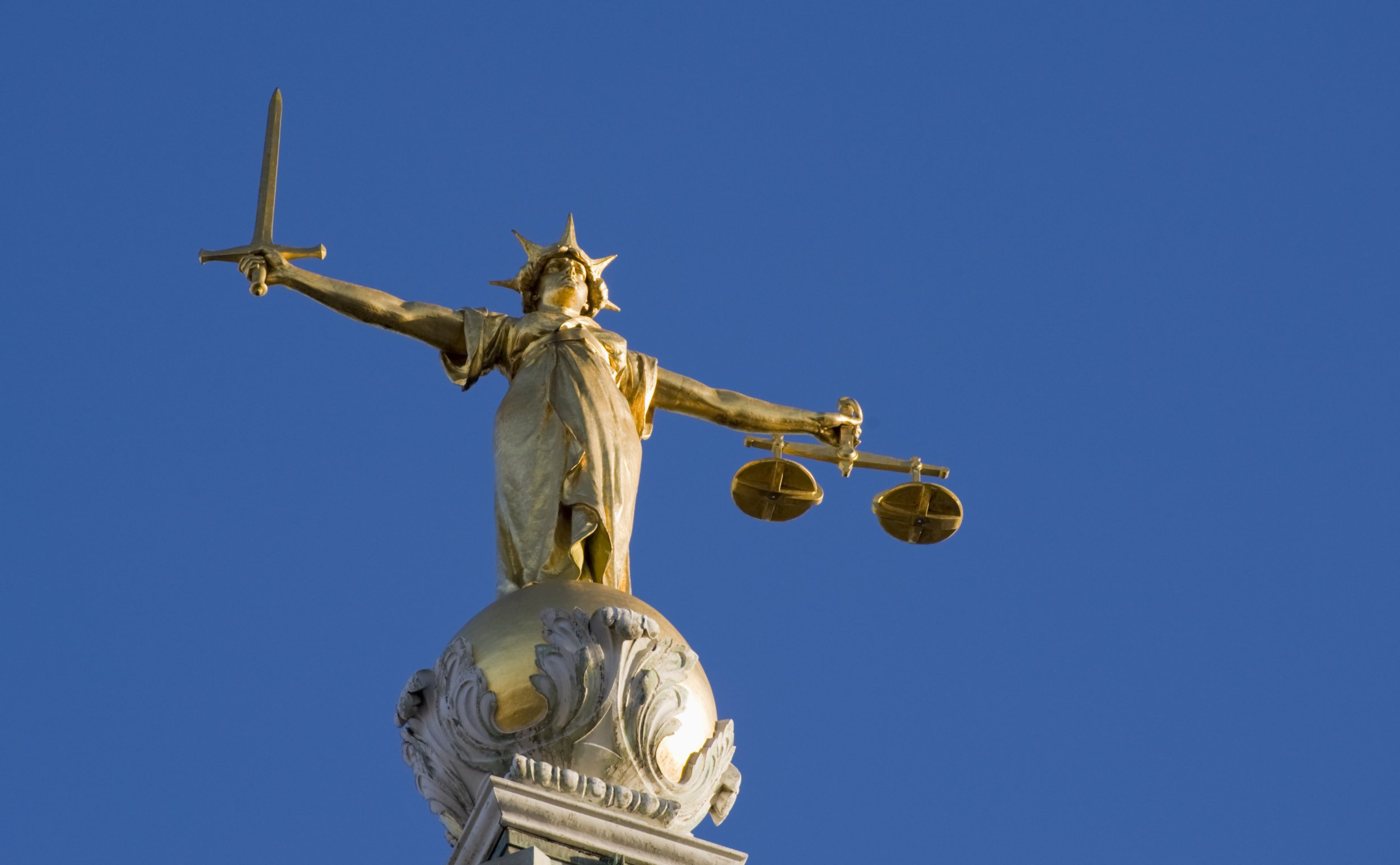 """""""The bronze statue (Lady Justice) above the dome of the Old Bailey Law Courts, London."""""""