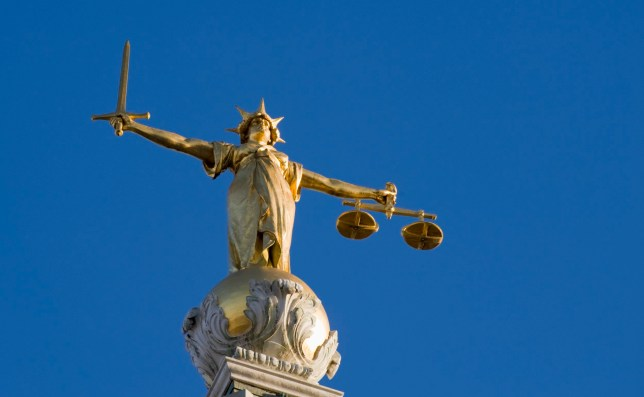 """The bronze statue (Lady Justice) above the dome of the Old Bailey Law Courts, London."""