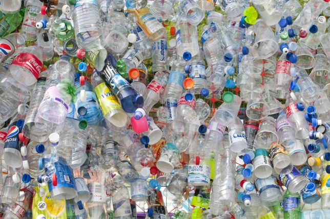 Mandatory Credit: Photo by Eye Ubiquitous/REX/Shutterstock (1906336a) Plastic bottles attached to a wire fence at the WOMAD festival to highlight the need to recycle non-sustaninable materials. Plastic Recycling Environment Environment