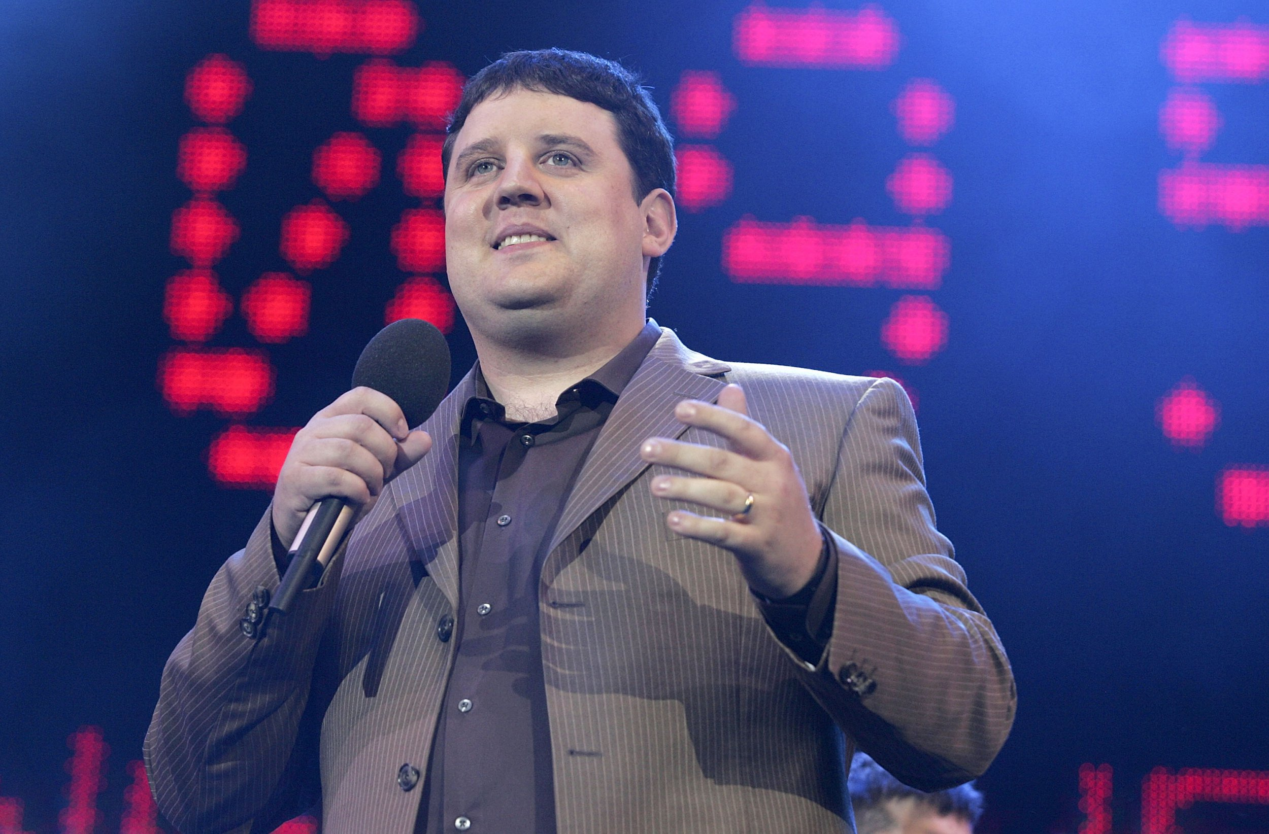 """LONDON - JULY 02: Comedian Peter Kay on stage at """"Live 8 London"""" in Hyde Park on July 2, 2005 in London, England. The free concert is one of ten simultaneous international gigs including Philadelphia, Berlin, Rome, Paris, Barrie, Tokyo, Cornwall, Moscow and Johannesburg. The concerts precede the G8 summit (July 6-8) to raising awareness for MAKEpovertyHISTORY. (Photo by Jo Hale/Getty Images)"""
