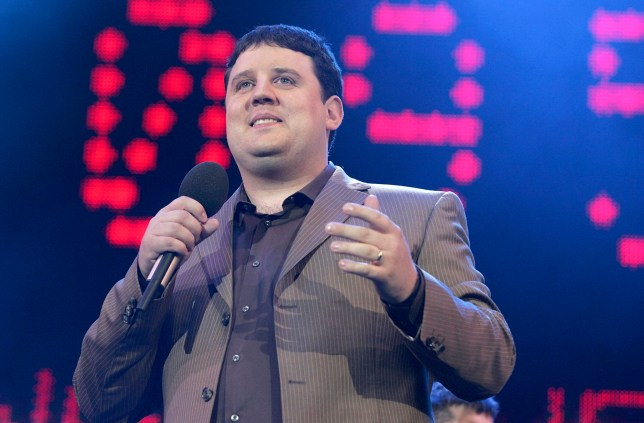 "LONDON - JULY 02: Comedian Peter Kay on stage at ""Live 8 London"" in Hyde Park on July 2, 2005 in London, England. The free concert is one of ten simultaneous international gigs including Philadelphia, Berlin, Rome, Paris, Barrie, Tokyo, Cornwall, Moscow and Johannesburg. The concerts precede the G8 summit (July 6-8) to raising awareness for MAKEpovertyHISTORY. (Photo by Jo Hale/Getty Images)"
