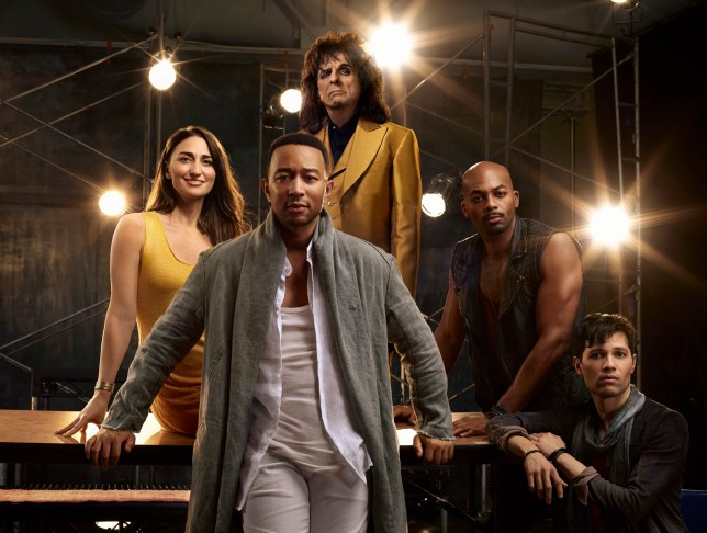 """This image released by NBC shows, clockwise from foreground center, John Legend as Jesus Christ, Sara Bareilles as Mary Magdalene, Alice Cooper as King Herod, Brandon Victor Dixon as Judas Iscariot and Jason Tam as Peter from the NBC production, """"Jesus Christ Superstar Live In Concert,"""" airing April 1. (James Dimmock/NBC via AP)"""