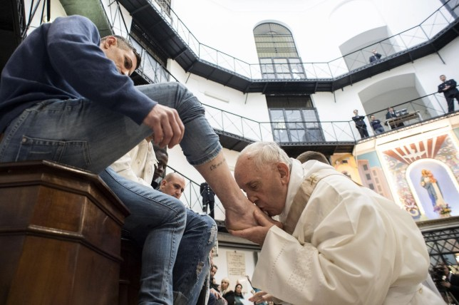 Pope Francis washes the feet of inmates during his visit to Regina Coeli prison where he celebrated the Mass in Coena Domini, Rome, Italy. EDITORIAL USE ONLY. NOT FOR SALE FOR MARKETING OR ADVERTISING CAMPAIGNS. Featuring: Pope Francis Where: Rome, Italy When: 29 Mar 2018 Credit: IPA/WENN.com ****Only available for publication in UK, USA, Germany, Austria****