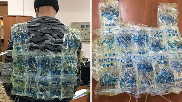 Man tries to smuggle 12 litres of Vodka into Russia using a dodgy vest