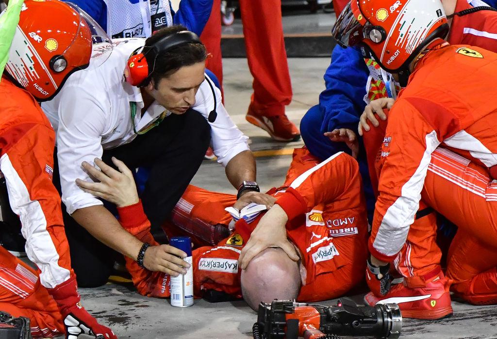 Sickening moment Kimi Raikkonen runs over own mechanic as Sebastian Vettel wins Bahrain GP