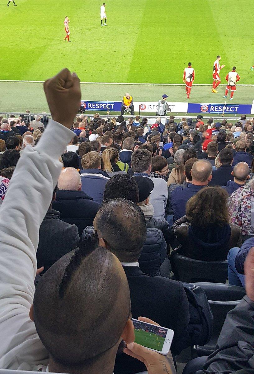 Bayern Munich star Arturo Vidal celebrates Juventus' third goal against Real Madrid while watching Sevilla clash