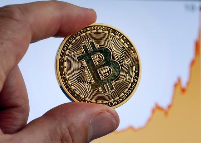 PARIS, FRANCE - NOVEMBER 30: In this photo illustration, a visual representation of the digital Cryptocurrency, Bitcoin in front of a Bitcoin chart is displayed on November 30, 2017 in Paris, France.The value of e-money has increased tenfold since the beginning of the year, and the price of Bitcoin has exceeded 10 000 US dollars. The value of Bitcoin rises and rises, but an investment risk remains. (Photo by Chesnot/Getty Images)